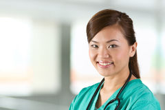 Portrait of a happy Female Doctor Stock Image