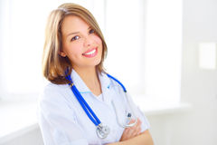 Portrait of a happy female doctor Stock Images