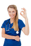 Portrait of happy female Doctor with okay gesture Stock Images