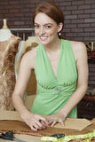 Portrait of happy female fashion designer working at design studio Royalty Free Stock Photos