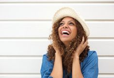Portrait of a happy female fashion model laughing royalty free stock photos