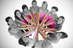 Portrait of happy female friends supporting breast cancer awareness stock photos