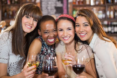 Portrait of happy female friends with wineglasses Royalty Free Stock Images