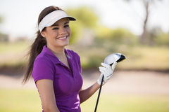 Portrait of a happy female golfer stock photo