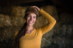 Portrait of happy female jockey in stable stock image
