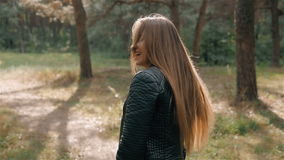 Portrait of happy female model in autumn forest. Student walking after lessons and dancing. Portrait of happy female hiker in autumn forest stock footage