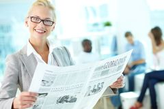 Female reading newspaper Royalty Free Stock Image