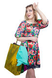 Portrait of happy female shopaholic with several. Happy female shopaholic with several paper bags Royalty Free Stock Photo