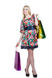 Portrait of happy female shopaholic with several. Happy female shopaholic with several paper bags Royalty Free Stock Images