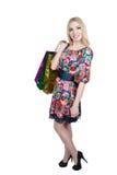 Portrait of happy female shopaholic with several. Happy female shopaholic with several paper bags Royalty Free Stock Image