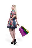 Portrait of happy female shopaholic with several Stock Image