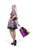 Portrait of happy female shopaholic with several. Happy female shopaholic with several paper bags Stock Image