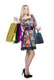 Portrait of happy female shopaholic with several Royalty Free Stock Photo