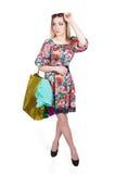 Portrait of happy female shopaholic with several. Happy female shopaholic with several paper bags Stock Photography
