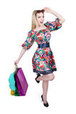 Portrait of happy female shopaholic with several. Happy female shopaholic with several paper bags Royalty Free Stock Photos