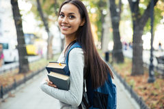 Portrait of a happy female student holding books Royalty Free Stock Photos