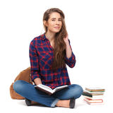 Portrait of happy female student reading a book isolated. Stock Photos