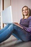 Portrait of happy female student using laptop Stock Image