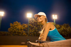Portrait of a happy female tennis player Royalty Free Stock Image