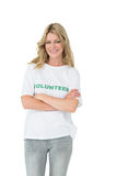 Portrait of a happy female volunteer with arms crossed stock photo
