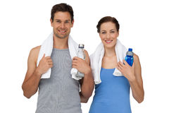 Portrait of a happy fit couple with water bottles Stock Photo