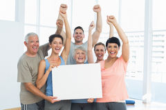 Portrait of happy fit people holding blank board Royalty Free Stock Image