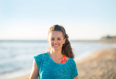 Portrait of happy fitness woman on beach in evening Stock Photo