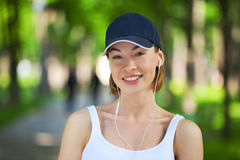 Portrait of happy fitness woman ready to start workout. Stock Image