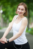 Portrait of happy fitness woman ready to start workout. Stock Photos