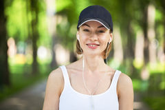 Portrait of happy fitness woman ready to start workout. Royalty Free Stock Photos