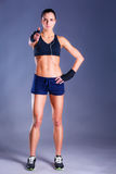 Portrait of a happy fitness woman showing ok sign Royalty Free Stock Images
