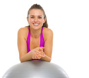 Portrait of happy fitness woman with fitness ball Royalty Free Stock Image