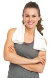 Portrait of happy fitness young woman with towel Stock Images