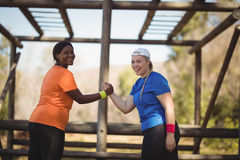 Portrait of happy friend holding hands during obstacle course stock photo