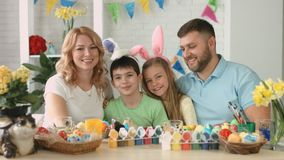 Portrait of happy friendly family with two children during Easter celebration stock footage