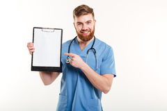 Portrait of happy friendly young medical doctor or a nurse Royalty Free Stock Images
