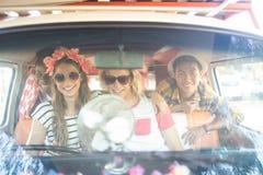 Portrait of happy friends in camper van seen through windshield Royalty Free Stock Photo