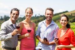 Portrait of happy friends having wine Royalty Free Stock Photos