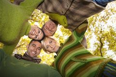 Portrait of happy friends with heads together Royalty Free Stock Photo