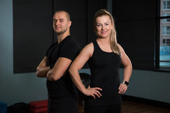 Portrait of happy friends standing at gym Stock Photos