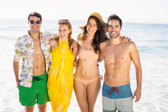 Portrait of happy friends standing together on the beach Stock Photo