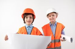 Future foremen holding house drawing. Portrait of happy friends trying on the role of superintendents. Isolated on background Stock Image