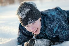Portrait of happy fun teenager in winter clothes Stock Image