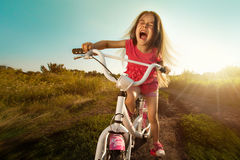 Portrait of happy funny girl on bicycle Royalty Free Stock Image