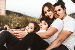 Portrait of a happy and funny young family outdoors royalty free stock image