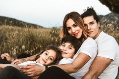 Portrait of a happy and funny young family outdoors royalty free stock photo