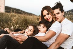 Portrait of a happy and funny young family outdoors stock photos