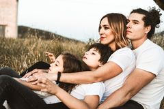 Portrait of a happy and funny young family outdoors royalty free stock photos