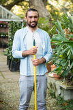 Portrait of happy gardener with hand tool at garden Stock Images