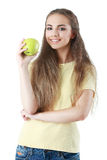 Portrait of happy girl with apple isolated on white background. Girl poses with fruit and water on white background Royalty Free Stock Image